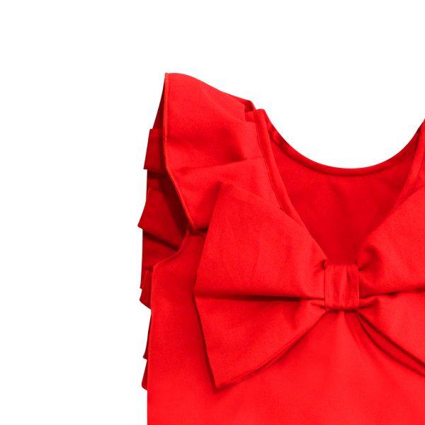 dettaglio fiocco pagliaccetto rosso in cotone da bambina