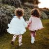 mantellina piumino calda a cuori bianchi da bambina